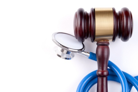 brown gavel and a medical stethoscope on white background Stock Photo - 17163479