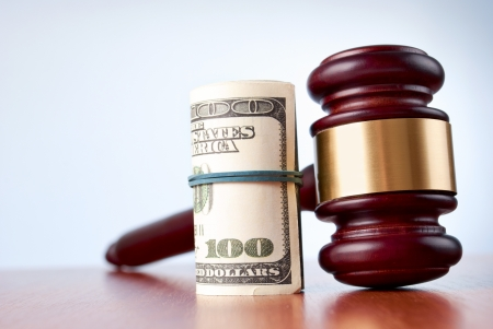 gavel and dollars on a gray gradient background Stock Photo - 17163573