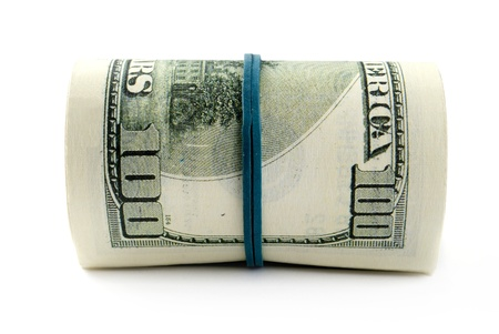 American dollars rolled up on white background Stock Photo - 17163631