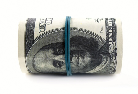 American dollars rolled up on white background Stock Photo - 17163614