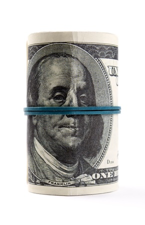 American dollars rolled up on white background Stock Photo - 17163603