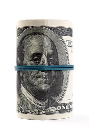 dolar: Dólares americanos enrollados sobre fondo blanco Foto de archivo