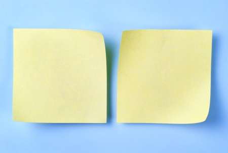 paper for important reminders on a blue background Stock Photo - 17163580