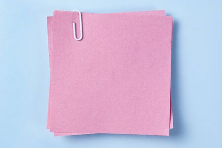 paper for important reminders on a blue background Stock Photo - 17163610
