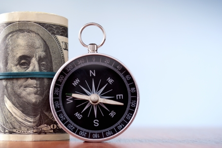American dollars and compass on a blue gradient background Stock Photo - 17163609