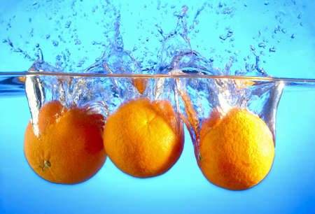 Orange falls into the water and making splashes Stock Photo - 17467111