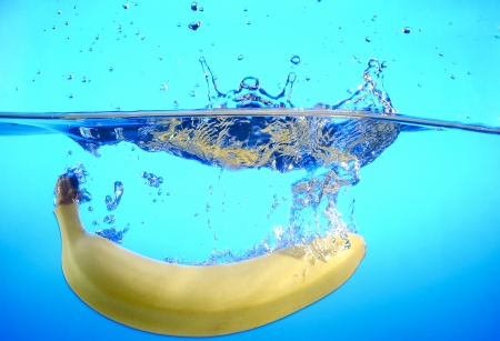 banana drops into the water and making splashes Stock Photo - 17467121
