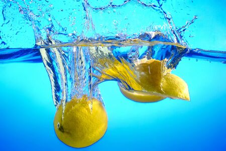 Lemon fell into the water, splashes and bubbles Stock Photo - 17467114
