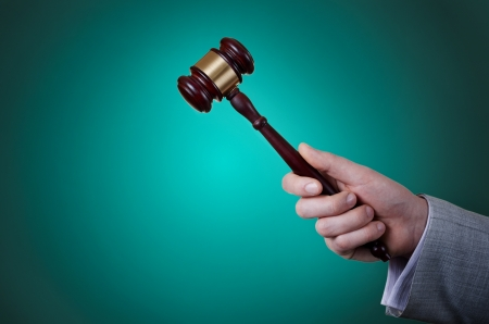 gavel in the hand of a man in a business suit Stock Photo - 17467117