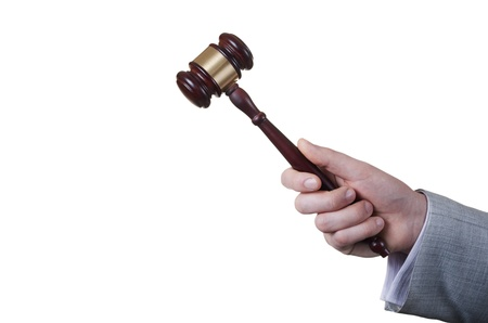 gavel in the hand of a man in a business suit Stock Photo - 17467109