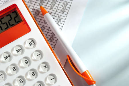 data sheet: calculator and stationery items on the table Stock Photo