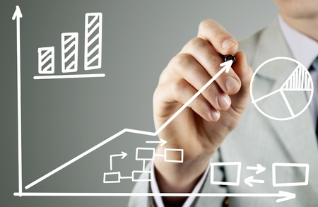 man in a business suit writing on a transparent screen during a presentation Stock Photo