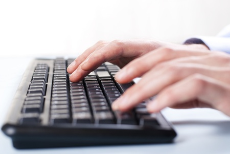 typing man: Businessman typing on a computer keyboard