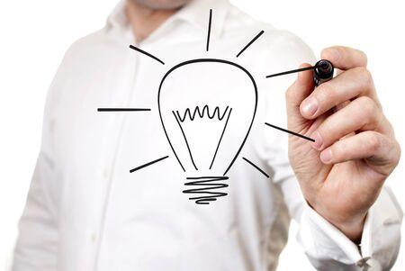 contribution: Businessman draws a light bulb, the symbol of the idea of Stock Photo
