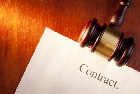 brown gavel on the table and the contract Stock Photo