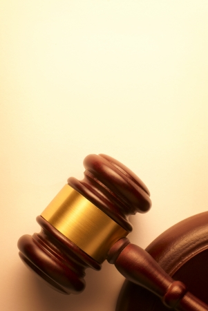 verdicts: gavel on a brown gradient background