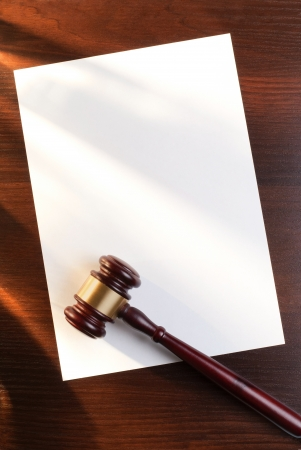 judges gavel on the table and a sheet of paper for the contract