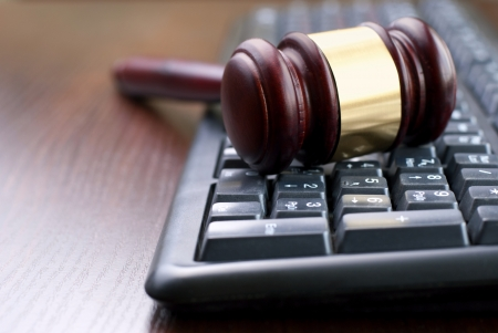 law symbol: gavel and computer keyboard, conceptual image