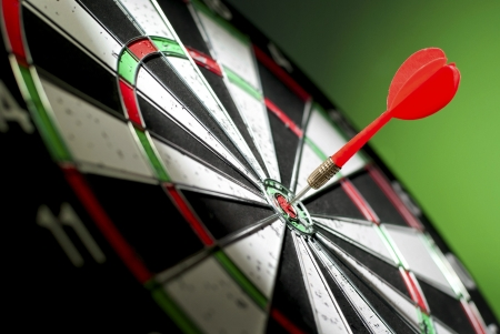throw up: darts arrows in the target center Stock Photo