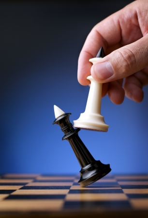 moves: game of chess white king affects black king chess player and the visible hand Stock Photo