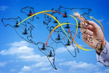 migration: Finger touching a virtual map of an international social network made of members from all over the world, with the sky as background