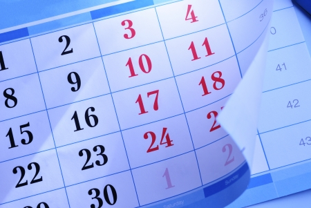 flipped: Calendar showing the month and individual days with the corner flipped up to reveal part of the month below