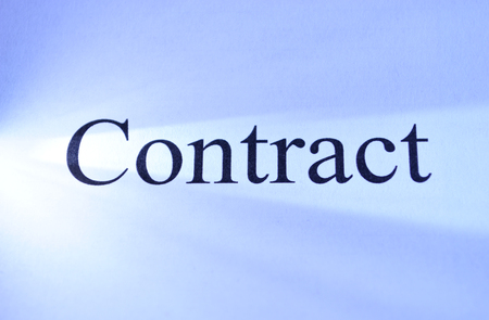 legally: Contract heading on a document signifying a legally binding business agreement, deal or partnership Stock Photo