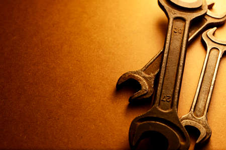 spanners: Set of three different sized spanners in a sepia toned image with a graduated background and copyspace