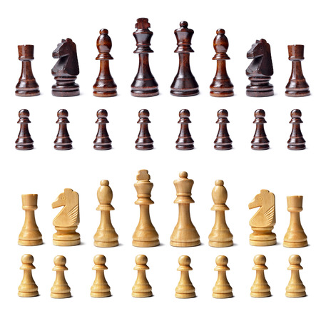 complement: Complete wooden chess set with s full complement of chess pieces in both colours lined up in rows isolated on a white background