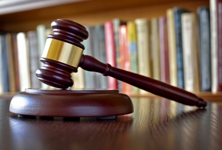 rightness: Close-up of a vintage gavel, on blurred background, symbol of impartiality and rightness, judicial decisions, closed cases and justice Stock Photo