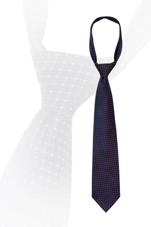 knotted: Knotted mans necktie isolated on white with a small pattern of dots on a dark navy blue with copyspace over an enlarged feint repeat image of the same tie Stock Photo