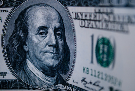benjamin franklin: Detail of a 100 dollar American dollar bill with the portrait of Benjamin Franklin in a money, currency and financial concept Stock Photo