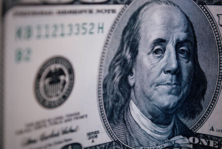 benjamin franklin: Benjamin Franklin portrait detail on an American 100 dollar bill with curved perspective in a wealth, success, business and financial concept