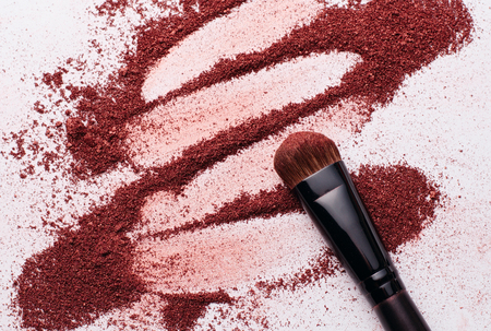 Make-up Powder and a Brush with white background
