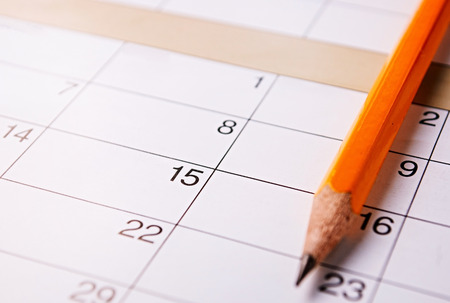 Pencil lying on a calendar with blank squares and dates conceptual of schedules, reminders and organization Stock Photo - 32607545