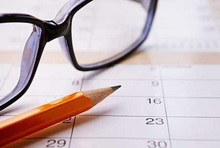 calender: Calendar, pencil and glasses for planning important things and to set a date.