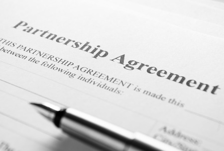 emphasizing: Close up Partnership Agreement Paper and Pen, Emphasizing the Title Part.