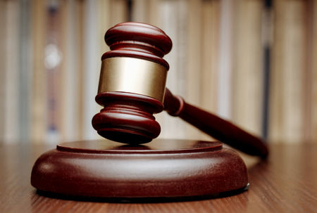 brass  band: Judges wooden gavel with a decorative brass band resting on a wooden plinth on a table in court Stock Photo