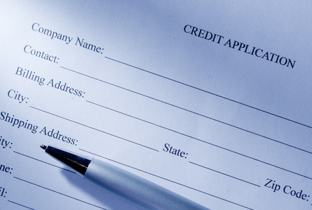 Close up Conceptual Blank Credit Application Form and Pen on Top of the Table. Stock Photo