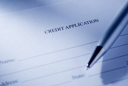 business credit application: Close up Conceptual Blank Credit Application Form and Pen on Top of the Table. Stock Photo