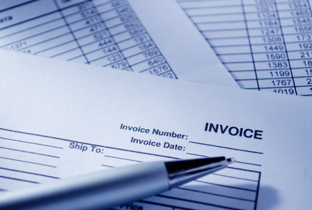 emphasizing: Close up Invoice Documents and Pen on Top of Table, Emphasizing Invoice Number and Date. Stock Photo