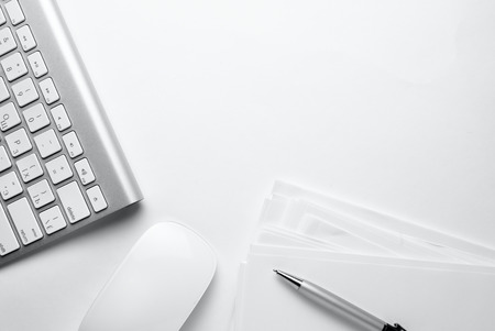 Conceptual White Office Stuffs on Top of White Table with Copy Space for Texts On Upper Right Side. Stock Photo