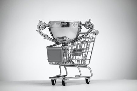 awarding: Silver Cup in food cart on a light background Stock Photo