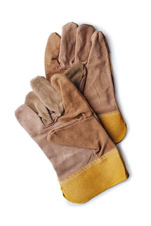 overlapped: Pair of new natural brown leather gardening or workmans gloves lying overlapped on a white background, overhead view