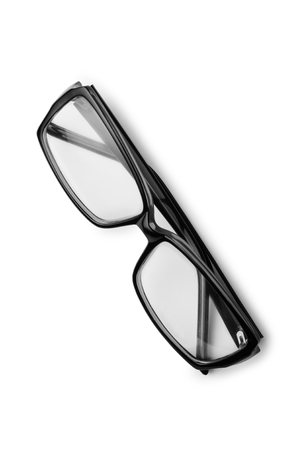 gafas: Par de anteojos para leer o gafas con marcos oscuros modernos cruzados sobre un fondo blanco, vista desde arriba