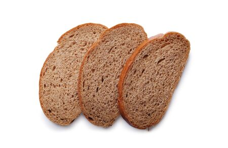 overlapped: Three slices of freshly baked healthy rye bread lying overlapped on a white background, overhead view