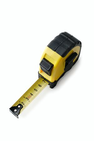high scale: Retractable tape measure with a centimeter scale viewed high angle on white in a household object and construction concept