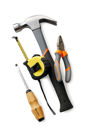 Assortment of hand tools with a claw hammer, screwdriver, pliers and tape measure in a DIY, renovation and construction concept photo