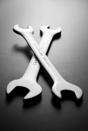 chrome vanadium: Two chrome vanadium spanners or wrenches with boxing ends lying on a dark background, low angle view in a DIY, renovation and maintenance concept