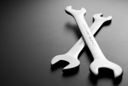 close up  wrench: Close up Open Ended Wrenches hand Tools on a Gray Background with Copy Space on the Left Side. Stock Photo